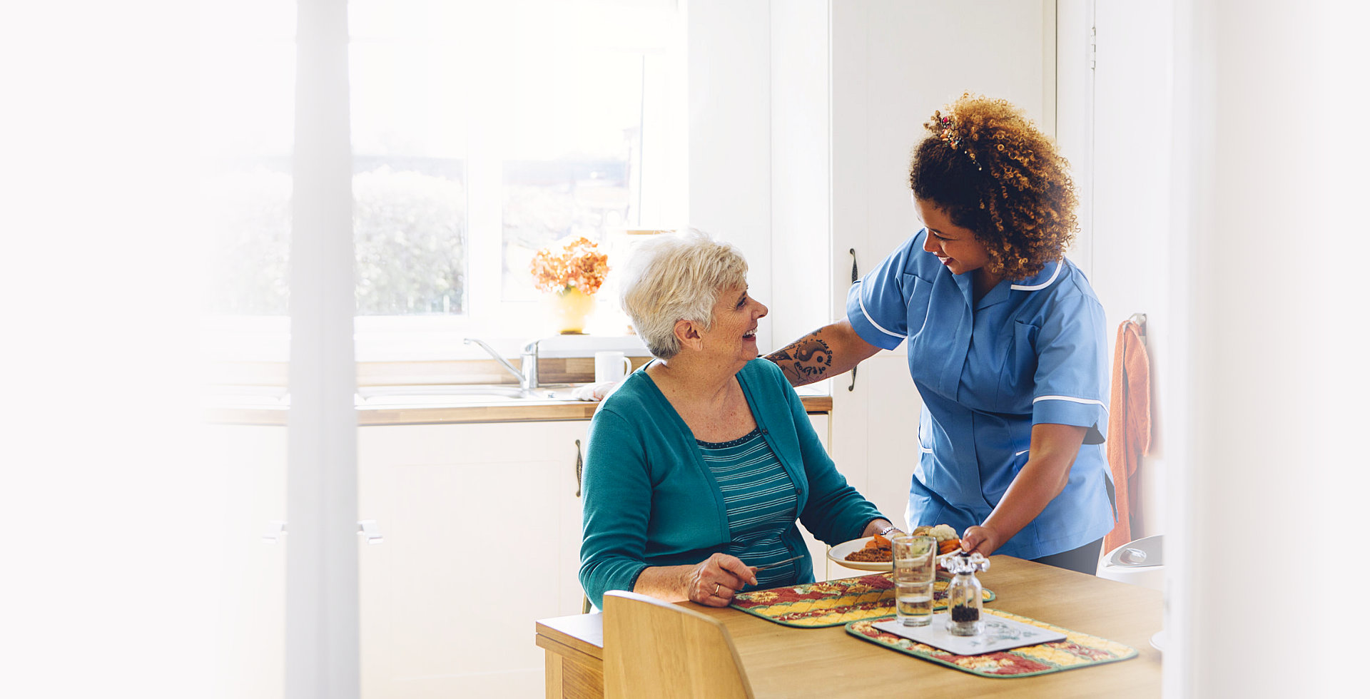 caregiver serving an elder woman